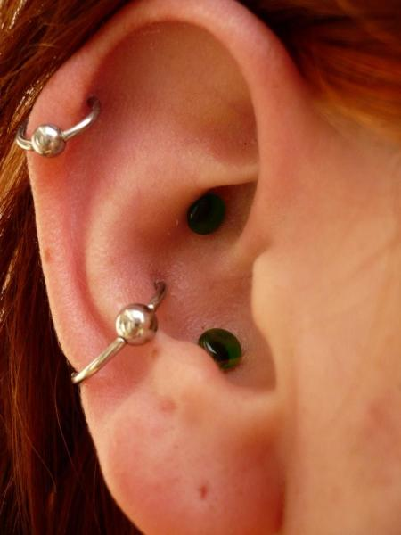 BEARDED LADY PIERCING NORTHAMPTON PROVINCETOWN BODY ART CONCH PIERCING WITH 10G GLASS PLUGS CAPTIVE BEAD RINGS